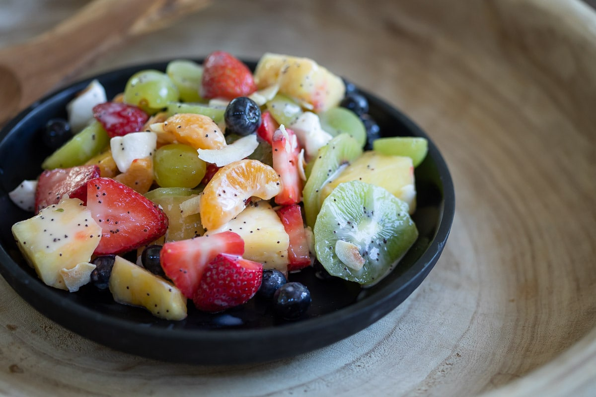 Dairy free fruit salad served in a black bowl