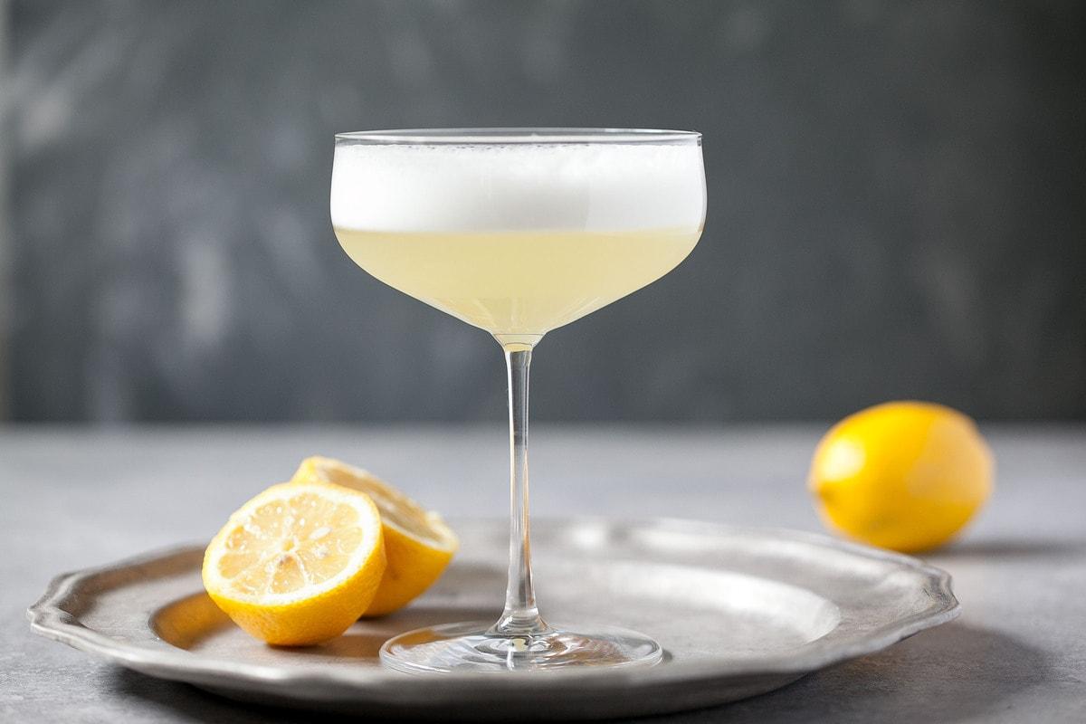 Martini glass full of a paleo friendly Pisco sour.