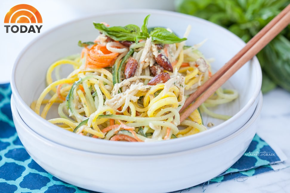 A bowl of Tangled Thai Salad using spiralized beets, cucumber, jicama, and carrots with a tangy and spicy Thai dressing.