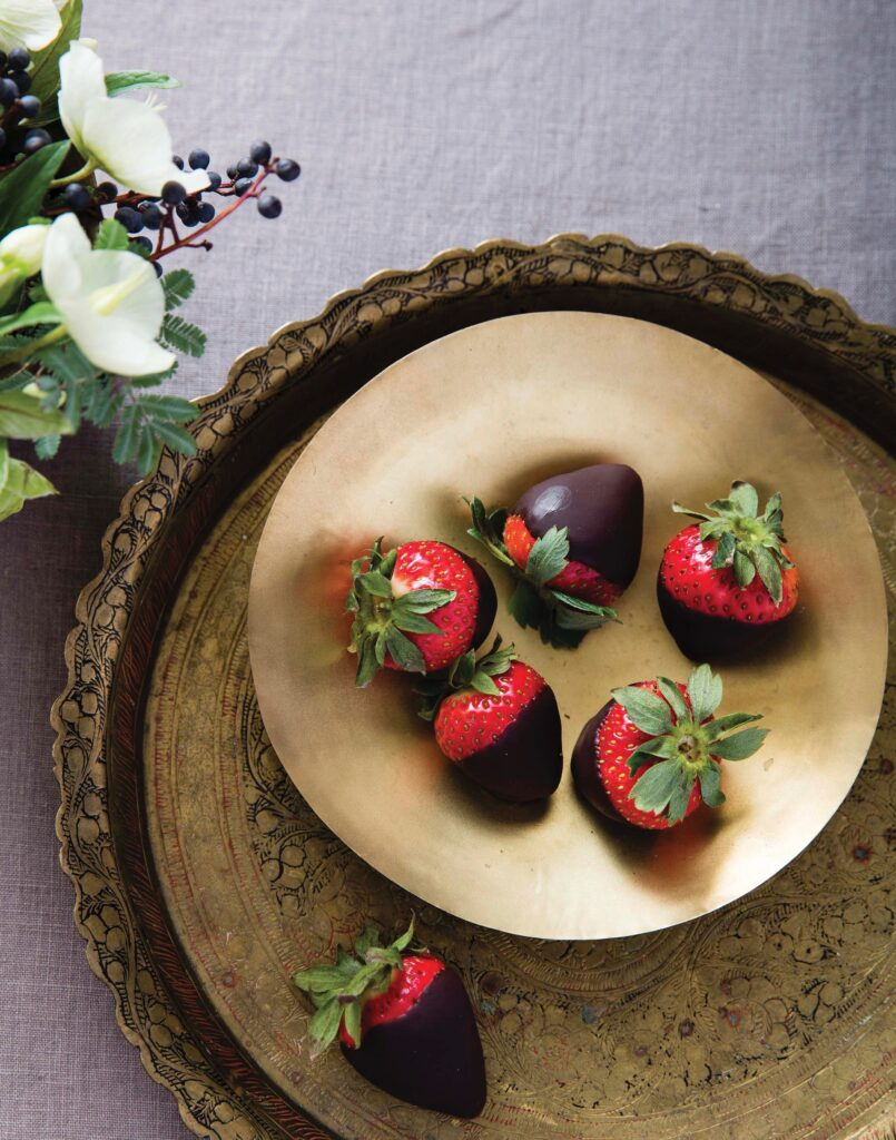 Chocolate Champagne dipped strawberries served on a gold dish