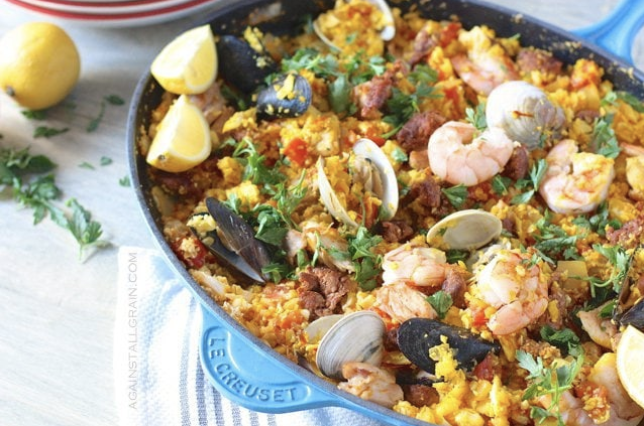 grain free Seafood Paella in a blue Le Creuset skillet