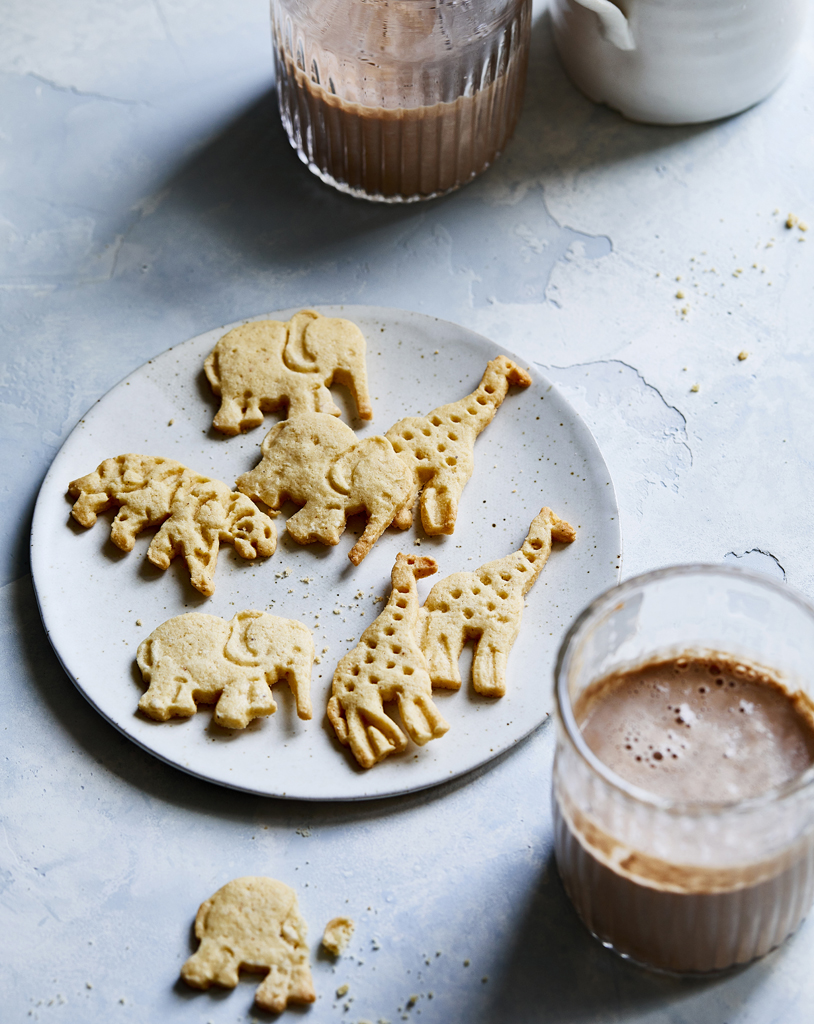 Paleo Animal Crackers on a white plate near glasses of chocolate milk