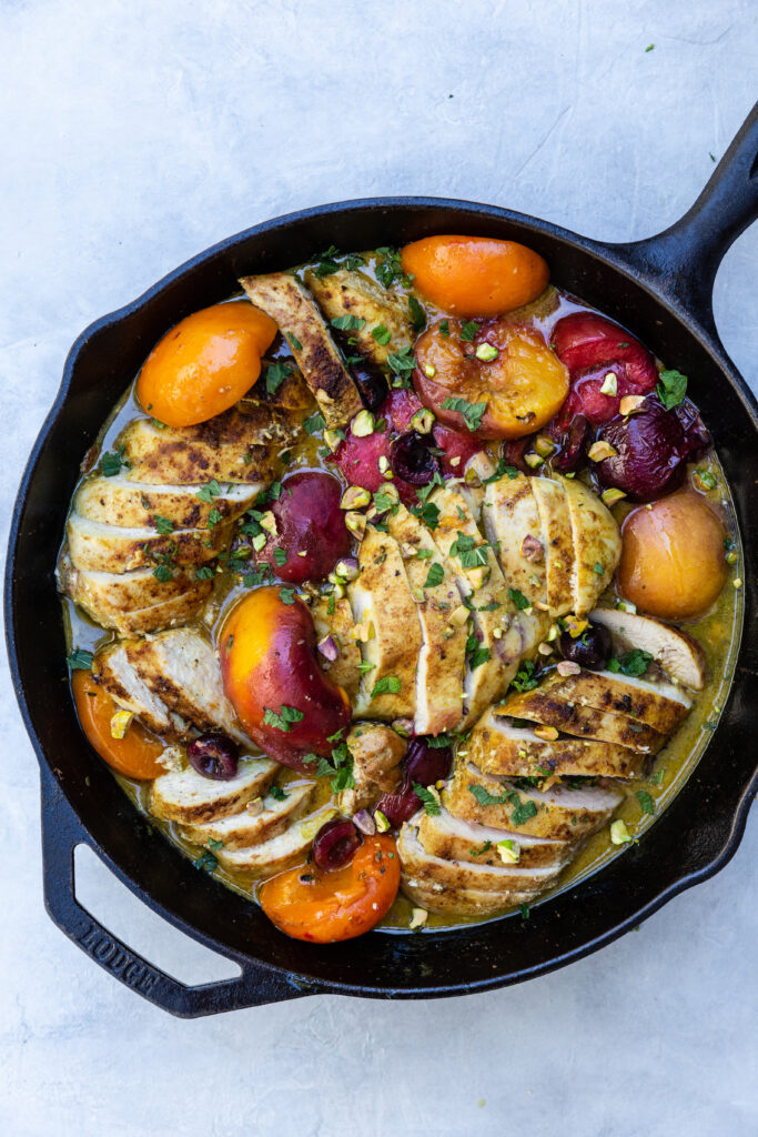 Roasted Chicken with Honey-Thyme Stone Fruits in a black cast iron skillet